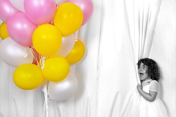 little girl with colourful ballons