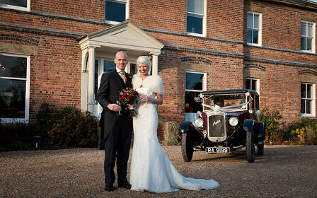 Laura and Andy outside Shottle Hall.