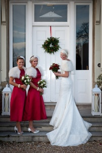 Laura's bridesmaids wore a stunning red, sinpired by the bride's ruby engagement ring.