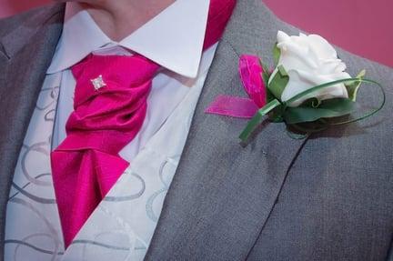 The groomsmen wore silk flowers