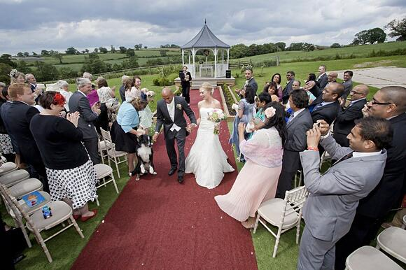 Couple getting married outside at shottle hall