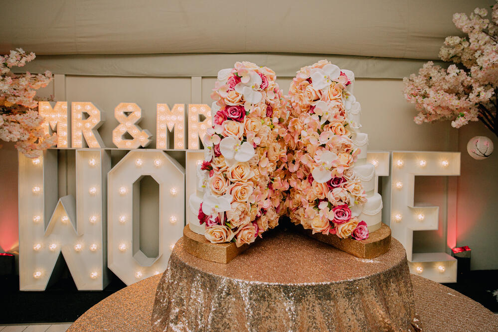 Split Flower Wall Wedding Cake